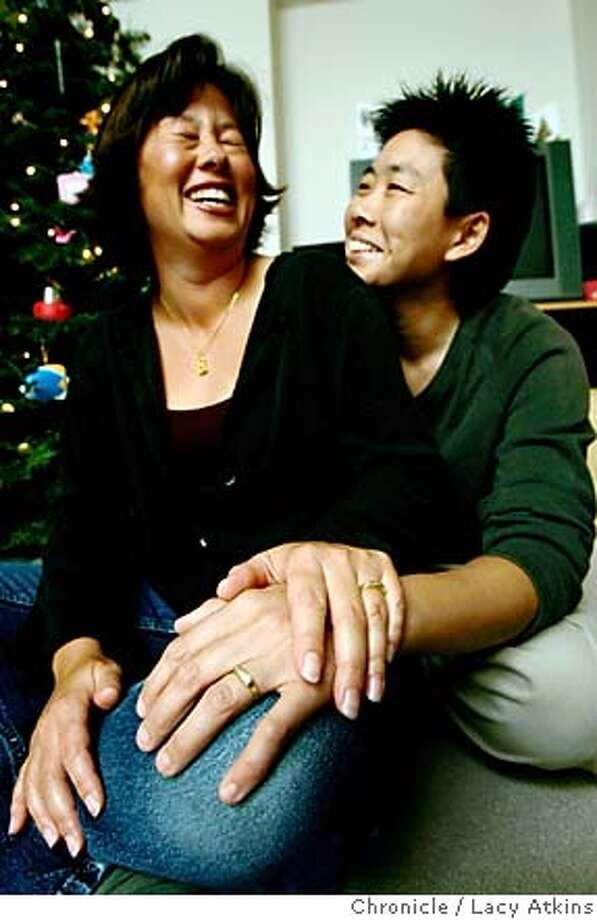 (left to right) Cristy Chung and Lancy Woo, are lead plaintiffs in the same-sex marriage case, share a laugh at their home in San Francisco. They have spent 17 Christmas together as partners of 17 years.  LACY ATKINS/SAN FRANCISCO CHRONICLE Photo: LACY ATKINS
