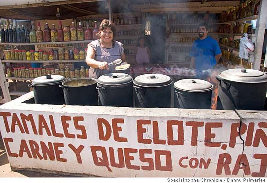 A woman and her family make and sell nearly a dozen types of tamales on the road to the famous La Bufadora tidal blowhole. Photo credit: Danny Palmerlee  !!ONE TIME USE ONLY FOR SUNDAY TRAVEL!!  This photo will probly be cover_lede Photo: Unknown
