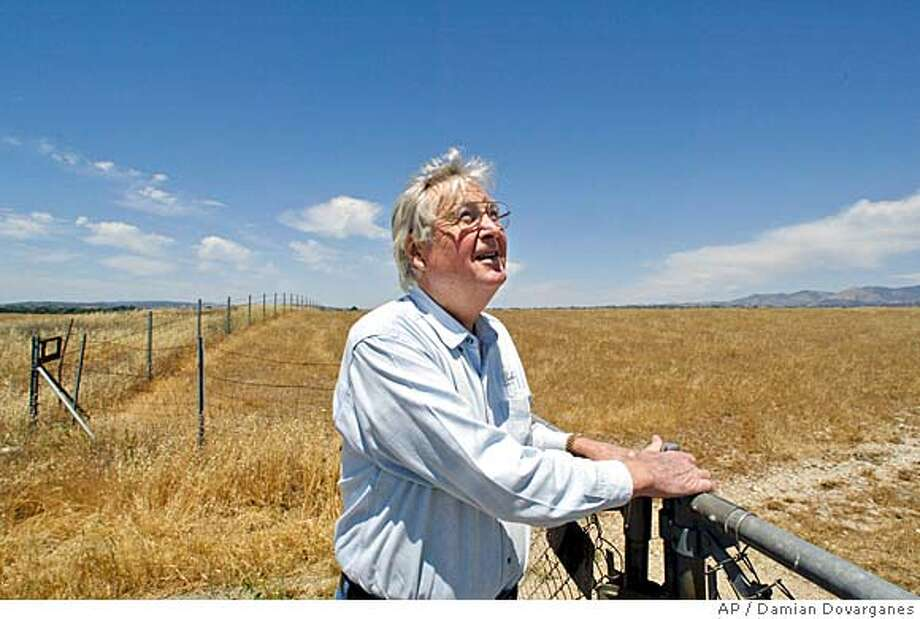 ** ADVANCE FOR SUNDAY, JUNE 6 ** Actor Fess Parker stands on his property in Santa Ynez, Calif., May 6, 2004. When Parker couldn't gather Santa Barbara County support to build a resort on his land, he turned to the Santa Ynez Band of Chumash Indians, touching off a bitter dispute between residents and the tribe over land use. (AP Photo/Damian Dovarganes) Ran on: 06-13-2004  Fess Parker, former star of &quo;Daniel Boone&quo; and &quo;Davy Crockett,&quo; stands on his property in Santa Ynez. MAY 6, 2004 PHOTO; ADV. FOR SUNDAY, JUNE 6 Photo: DAMIAN DOVARGANES