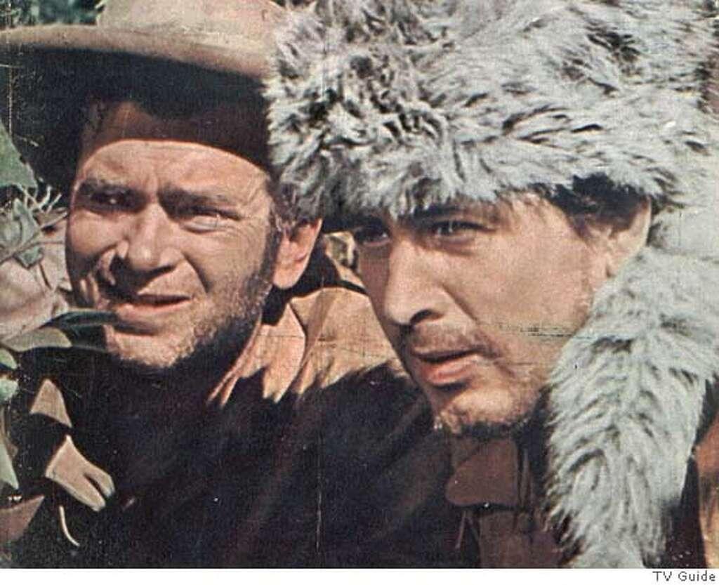 "Buddy Ebsen as George and Fess Parker as Davy Crockett in ""Davy Crockett."""