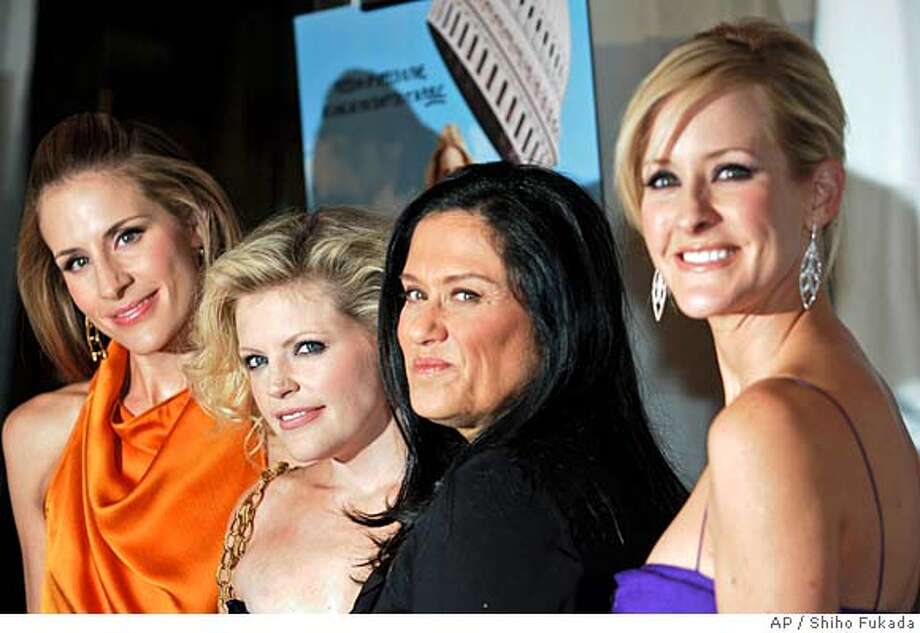 """Emily Robison, left, Natalie Maines, second left, Martie Maguire, right, of The Dixie Chicks, and director Barbara Kopple arrive at the premiere of their documentary """"Shut Up & Sing"""" in New York, Tuesday, Oct. 24, 2006. (AP Photo/Shiho Fukada) Photo: SHIHO FUKADA"""