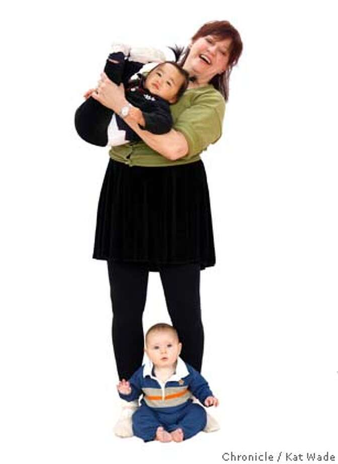 BABIES_0123_KW_.jpg Marian Roth-Cramer, who teaches an exercise class for infants at the San Francisco Richmond District YMCA, poses with Sydney Lee, 14 mos and Cole Kanter 6 mos, two of her students Monday October 2, 2006. facetime Kat Wade/The Chronicle Mandatory Credit for San Francisco Chronicle and photographer, Kat Wade, Mags out