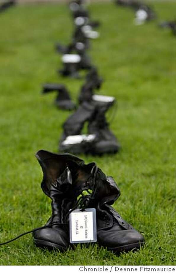 boots12_0153_df.jpg  Front boots are representing SPC Glenn J. Watkins, 42, from Carlsbad.On Veteran's Day, on the grounds of USF, 300 pair of boots, one to represent each of the California soldiers lost in Iraq were set out on display in the grass, in front of the Gleeson Library. Photographed in San Francisco on 11/11/06. (Deanne Fitzmaurice/ The Chronicle) Photo: Deanne Fitzmaurice