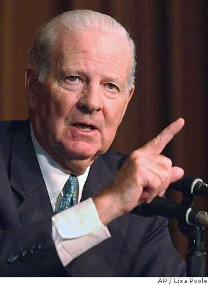 Former Secretary of State James A. Baker III gestures as he answers a question about U.S. foreign policy during a speech at the John F. Kennedy Library and Museum, Monday, May 5, 2003, in Boston. (AP Photo/Lisa Poole) Photo: LISA POOLE