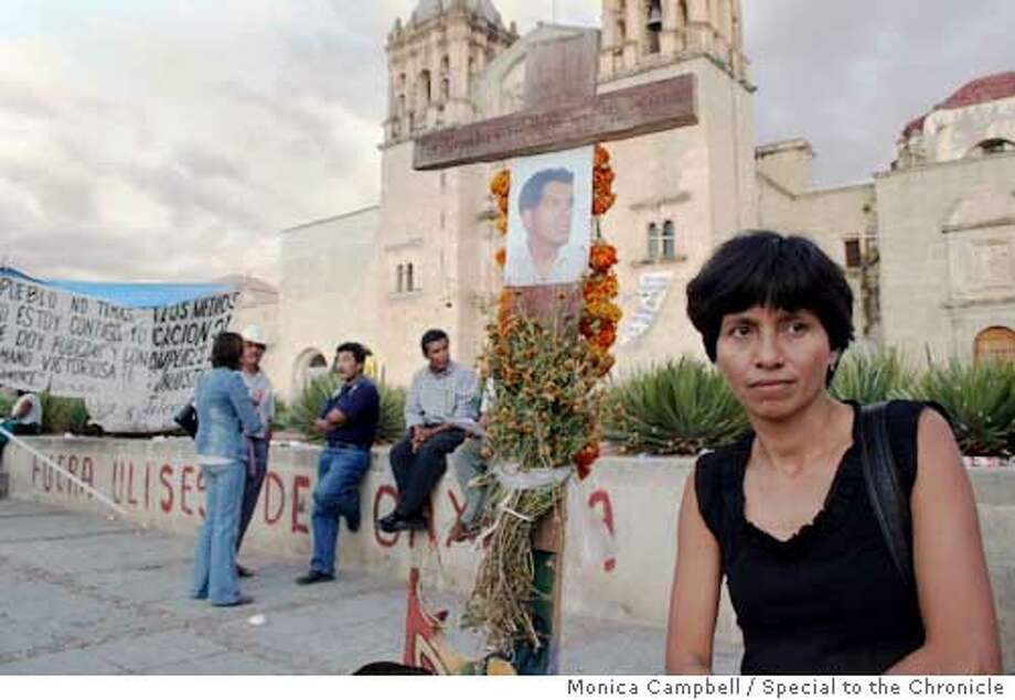 #3 caption: Carmen Marin, 39, stands next to a vigil to her husband, Alejandro Garcia, who was  killed by in front of a protest barricade by his house in the capital of the southern state of  Oaxaca. MONICA CAMPBELL/SPECIAL TO THE CHRONICLE  Ran on: 11-12-2006  Carmen Marin stands next to a memorial to her husband, Alejandro Garcia, who was shot dead near a protesters' barricade. Photo: Monica Campbell
