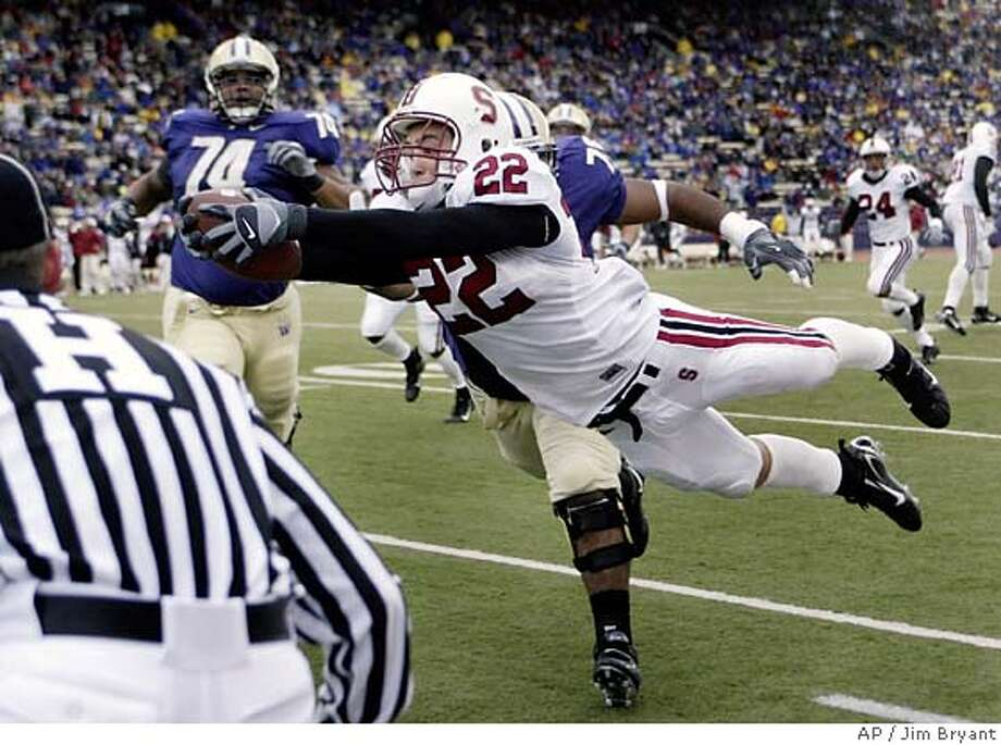 Stanford safety Bo McNally dives into the end zone for a 49-yard touchdown on an interception of a pass by Washington's Johnny DuRocher during the third quarter of a football game Saturday, Nov. 11, 2006, in Seattle. (AP Photo/Jim Bryant) Photo: JIM BRYANT