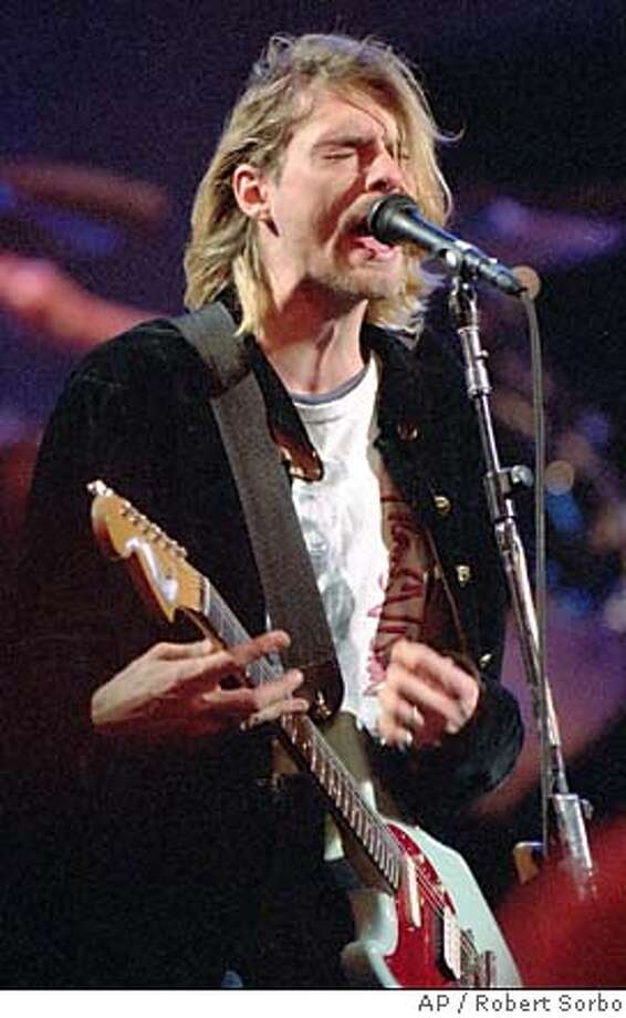 FILE-This is a December 13, 1993 file photo of Kurt Cobain, 28, lead singer of the Seattle-based rock group Nirvana during the taping of the MTV New Year's show in Seattle. Police are investigating a report Friday, April 8, 1994 that a body has been found at his Seattle home. There was no indication of who it was. Cobain was treated for an overdose of drugs March 4, 1994 in Rome. (AP Photo/Robert Sorbo) ALSO RAN 10/24/02, 01/08/2004 ALSO Ran on: 11-28-2004 CAT Photo: ROBERT SORBO