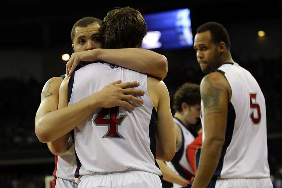 OMAHA, NE - MARCH 16:  (L-R) Rob Jones #22, Matthew Dellavedova #4 and Kyle Rowley #5 of the St. Mary's Gaels stand on court dejected after they lost 72-69 against the Purdue Boilermakers during the second round of the 2012 NCAA Men's Basketball Tournament at CenturyLink Center on March 16, 2012 in Omaha, Nebraska.  (Photo by Doug Pensinger/Getty Images) Photo: Doug Pensinger, Getty Images