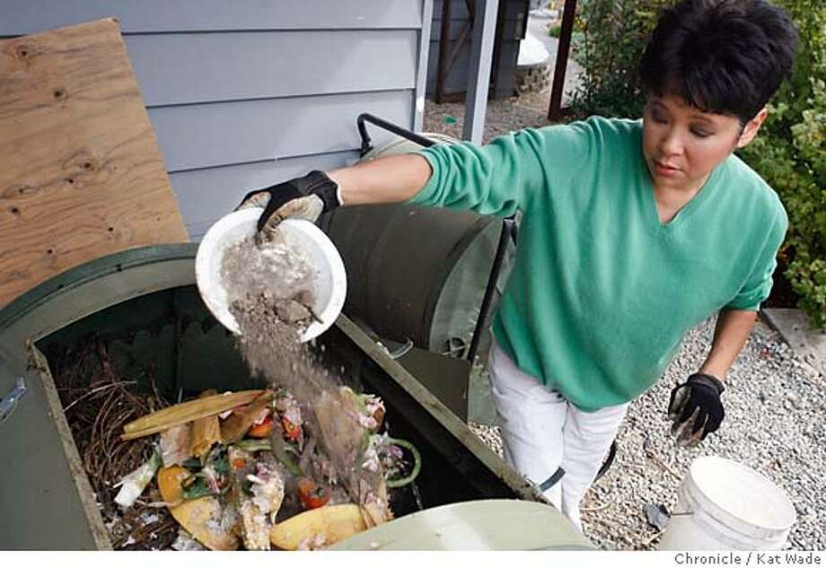 .jpg  Wendy Tokuda, a long-time member of the KRON4 news team, who keeps an earth-friendly home, fills her compost making machine with vegetables, scraps, cuttings and even a couple of handfulls of dirt. Tokuda recycles, makes her own compost and collects rainwater for her huge vegetable garden, uses gray water for her rose garden and has a roof covered in solar panels at her Oakland Hills home on Wednesday October 4, 2006. Kat Wade/The Chronicle Mandatory Credit for San Francisco Chronicle and photographer, Kat Wade, Mags out Photo: Kat Wade