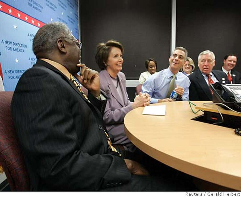House Minority Leader Nancy Pelosi, D-Calif. watches election returns at the Democratic Congressional Campaign Committee headquarters in Washington Tuesday, Nov. 7, 2006. With her, left to right, are Rep. Jim Clyburn, D-S.C., Rep. Rahm Emanuel, D-Ill., and Rep. Steny Hoyer, D-Md. (AP Photo/Gerald Herbert) Photo: GERALD HERBERT