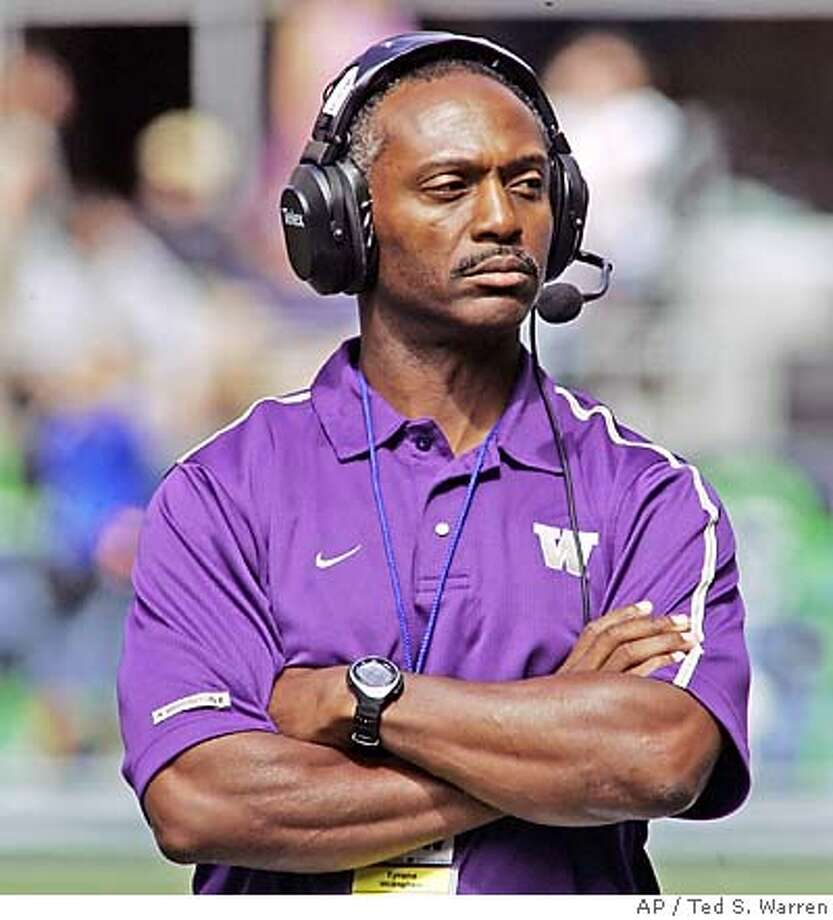 Tyrone Willingham stands on the field prior to his first game as Washington coach, a game against Air Force on Saturday, Sept. 3, 2005, in Seattle. A 13-point fourth-quarter rally by Air Force spoiled Willingham's debut as Air Force won 20-17. (AP Photo/Ted S. Warren) Ran on: 09-09-2005 Photo: TED S. WARREN
