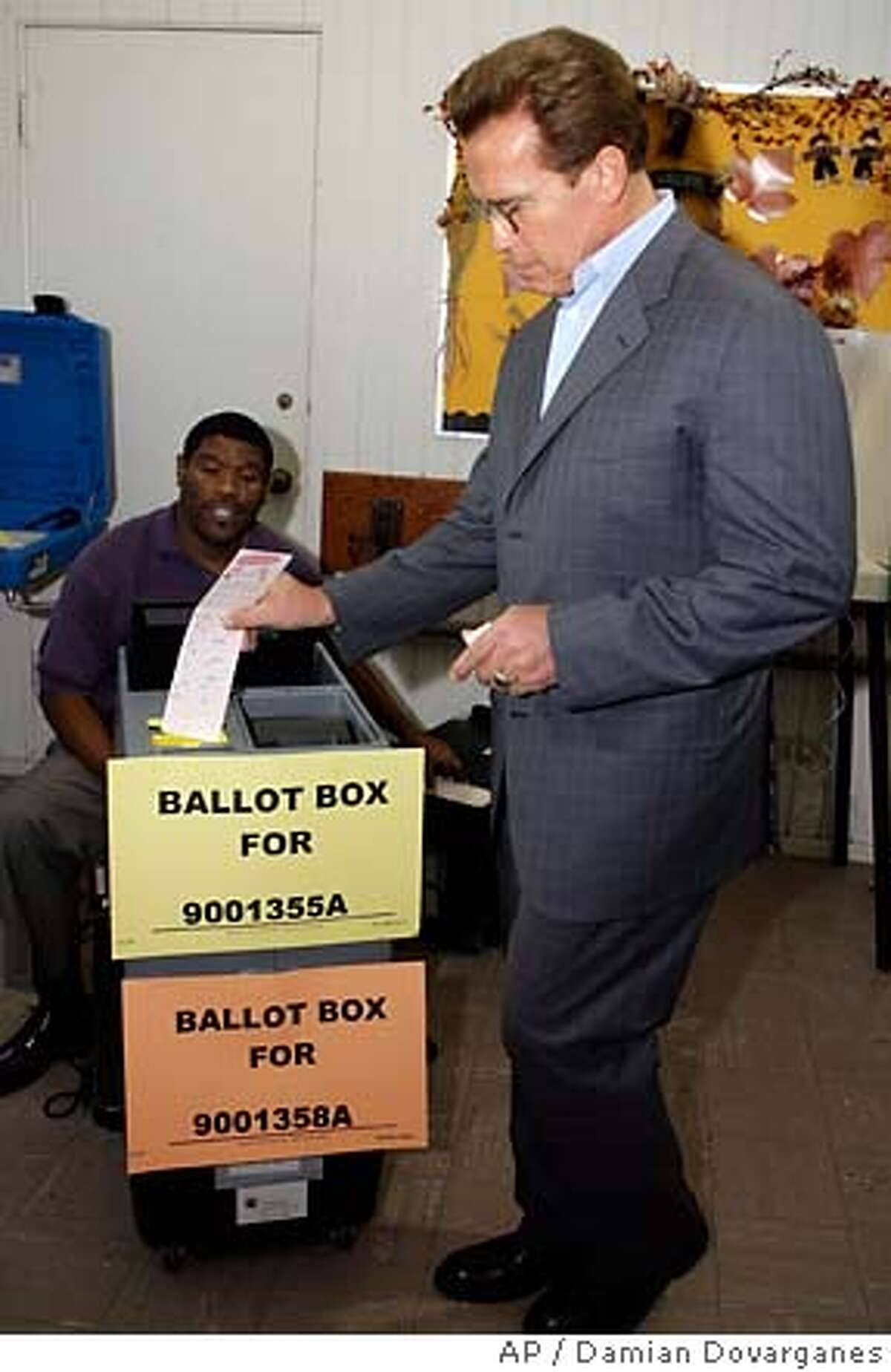Republican California Gov. Arnold Schwarzenegger casts his vote at the Crestwood Hills Recreation Center in Los Angeles Tuesday, Nov. 7, 2006. Democrat Phil Angelides is running against Schwarzenegger. (AP Photo/Damian Dovarganes, Pool)