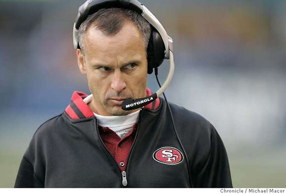 49ers_548_mac.jpg 49ers head coach MIke Nolan walks the sidelines in the 4th quarter as Seattles wins 41-3. San Francisco Forty Niners vs. Seattle Seahawks Event in Seattle, Wa on 12/11/05. Photo by: Michael Macor / San Francisco Chronicle Ran on: 12-12-2005  Coach Mike Nolan finally sounded a bit on the cynical side after Sunday's lopsided loss in Seattle, and who could blame him? Ran on: 12-12-2005  Coach Mike Nolan finally sounded a bit on the cynical side after Sunday's lopsided loss in Seattle, and who could blame him? Mandatory Credit for Photographer and San Francisco Chronicle/ - Magazine Out Photo: Michael Macor