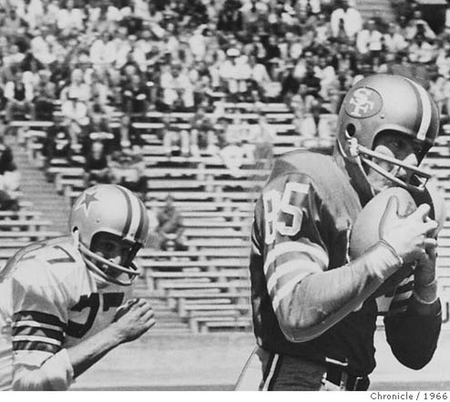 stickles07_PH1 Action photo: Monte Stickles, 49ers tight end, makes a catch against Dallas at Kezar Stadium in 1966.  Ran on: 09-07-2006  Monte Stickles played hard, rough football in an era when players weren't paid a lot and gave no quarter on the field.  Ran on: 09-07-2006 MANDATORY CREDIT FOR PHOTOG AND SF CHRONICLE/ -MAGS OUT Photo: Handout