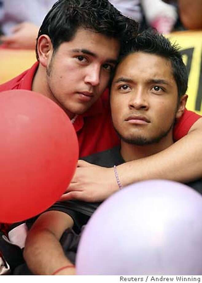 Ignacio and Carlos sit on the steps of Mexico City's local legislature November 9, 2006 as law makers inside debate an bill which would approve same sex civil unions in the capital. REUTERS/Andrew Winning (MEXICO) 0 Photo: ANDREW WINNING