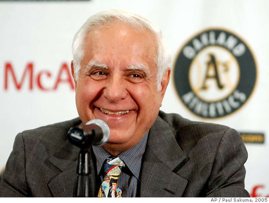 ** FILE **Oakland Athletics co-owner Lew Wolff smiles during a news conference in Oakland, Calif., Friday, April 1, 2005. The Oakland A's owners struck a deal with Major League Soccer to bring a team back to the San Francisco Bay area after the San Jose Earthquakes left for Houston over a stadium squabble, officials said Wednesday, May 24, 2006. Lew Wolff and John Fisher, the A's principal owners, will have three years to buy a team and develop a stadium solely for soccer. The location of the new stadium has not been determined but the new Earthquakes office will be located in downtown San Jose. (AP Photo/Paul Sakuma) Photo: PAUL SAKUMA