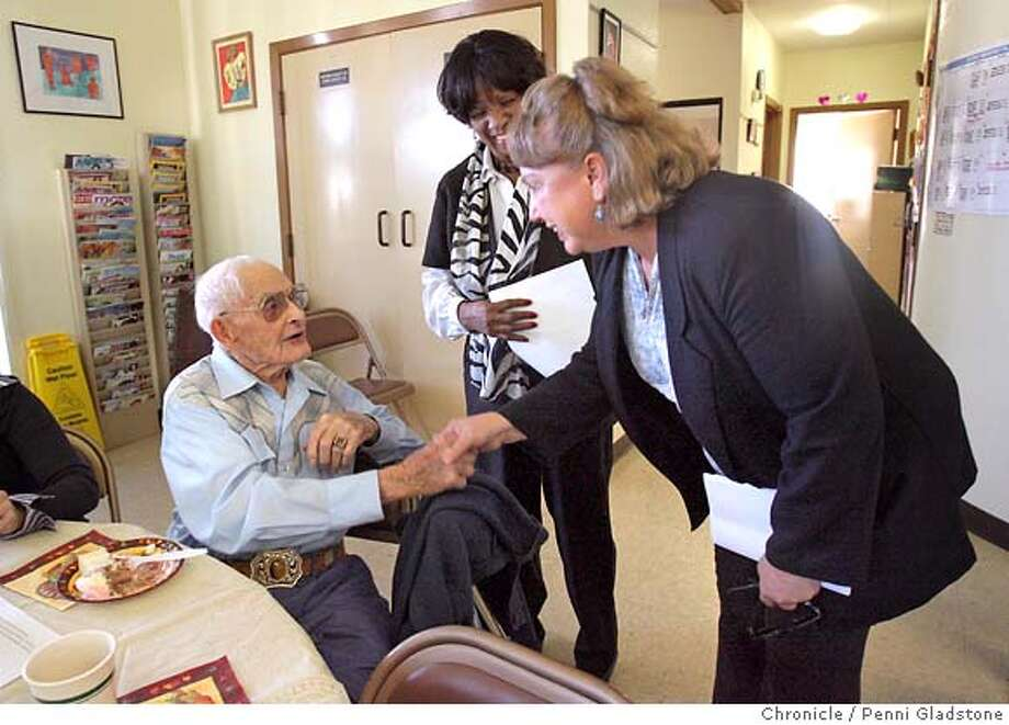 GREENMAYOR09  At the Richmond Annex Senior Center...at right is grassroots candidate Gayle McLaughlin. She won election as mayor of Richmond making the East Bay city the largest in America with a mayor who is a member of the Green Party. In the middle is, Kathy Myers Director of the Richmond Annex Senior Center. At left sitting is Alvin Grammer age 99 year old shaking hands, congratulating McLaughlin on her win as Mayor of Richmond. Event on 11/8/06 in Richmond.  Penni Gladstone / The Chronicle Photo: Penni Gladstone