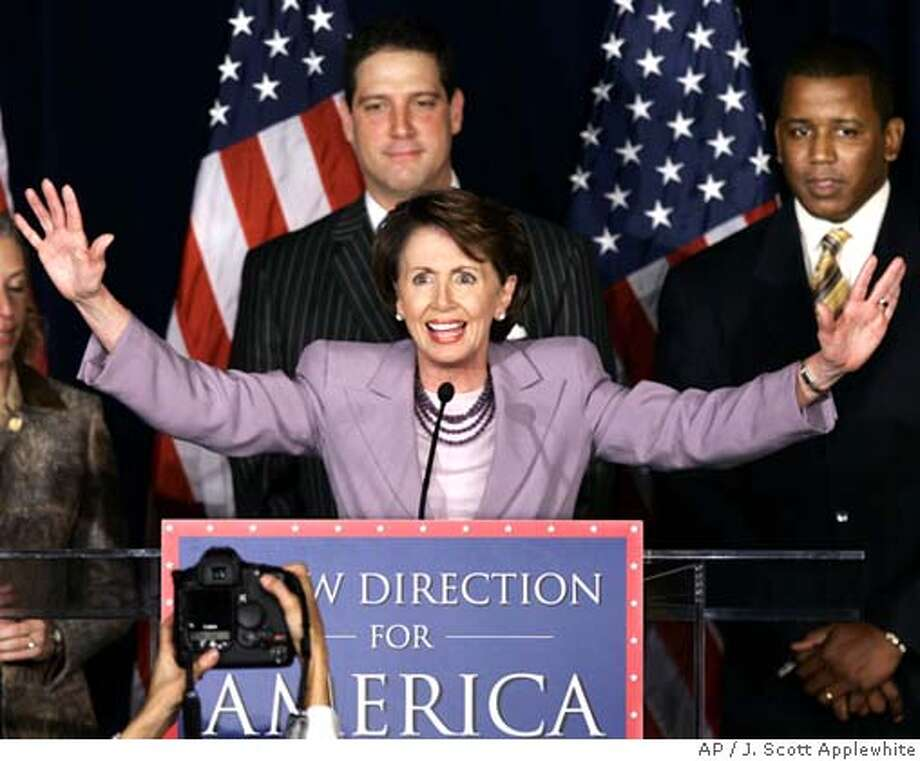 House Democratic Leader Rep. Nancy Pelosi, D-Calif., fires up fellow Democrats at an election night rally at the Hyatt Regency Hotel near the Capitol in Washington Tuesday, Nov. 7, 2006. She is joined, left to right, by Rep. Tim Ryan, D-Ohio, and Rep. Kendrick Meek, D-Fla. (AP Photo/J. Scott Applewhite) Photo: J. SCOTT APPLEWHITE