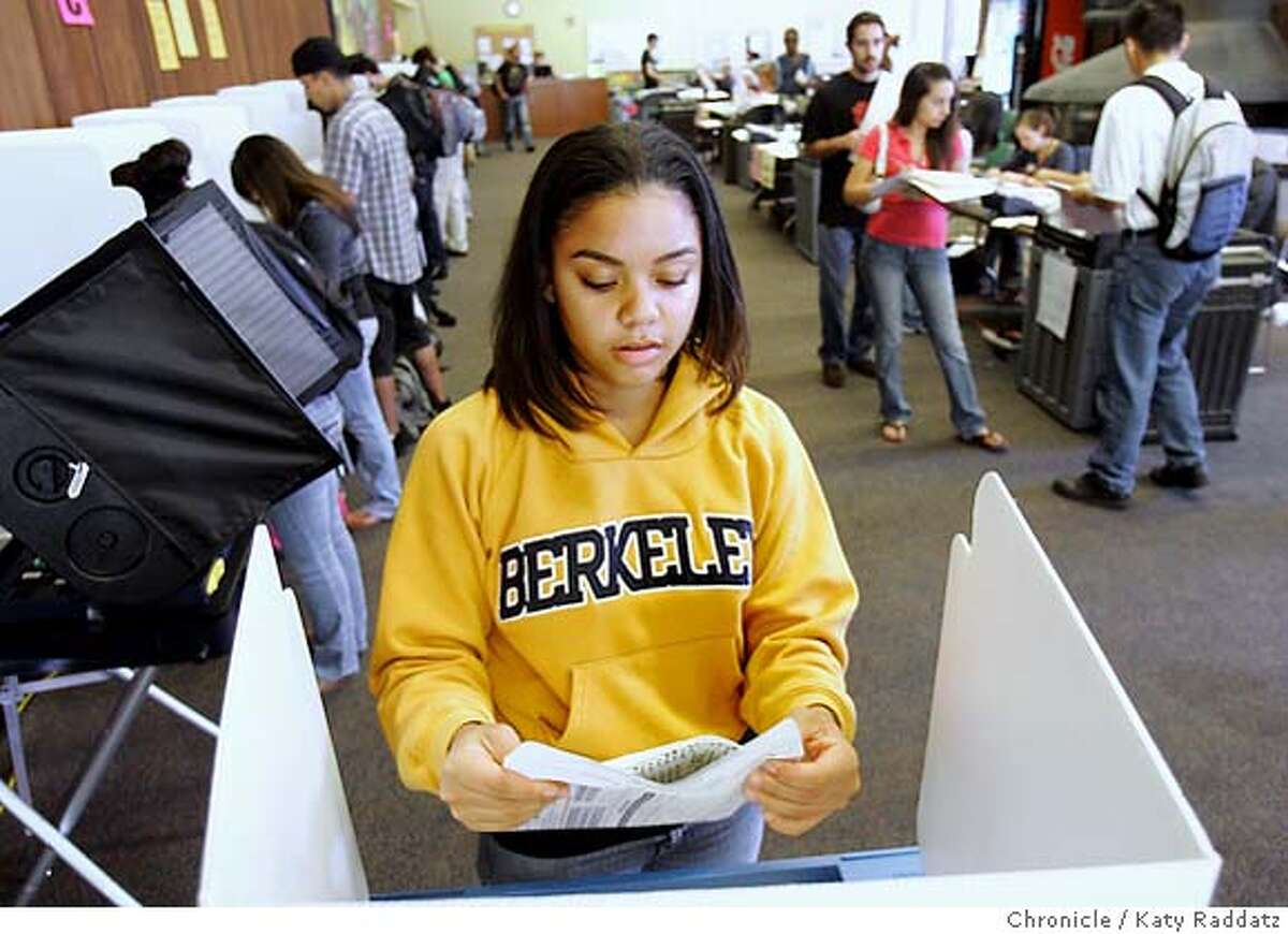 SHOWN: Lisa Hartley, age 21, a senior, finishes voting and seals her ballot. We go to the polling place in Heller Lounge, which is inside the Student Union Building on the University of California at Berkeley campus. These photos made on Tuesday, Nov. 7, 2006, in Berkeley, CA. (Katy Raddatz/San Francisco Chronicle) **Lisa Hartley
