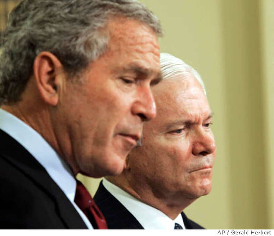 President Bush, left, accompanied by his Defense Secretary-nominee Robert Gates, makes the announcement in the Oval Office of the White House in Washington, Wednesday, Nov. 8, 2006. (AP Photo/Gerald Herbert) Photo: GERALD HERBERT