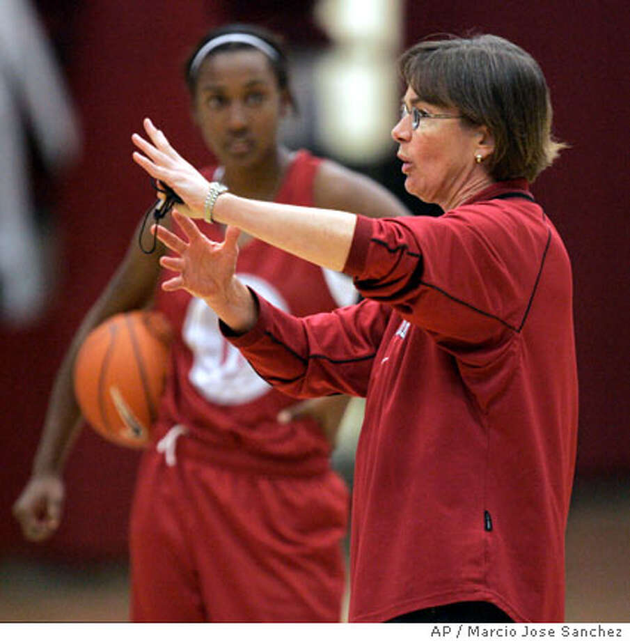 ** ADVANCE FOR WEEKEND EDITIONS, OCT. 28-29 ** Stanford head coach Tara VanDerVeer directs her team as guard Candice Wiggins looks on during practice at Maples Pavillion in Stanford, Calif., Monday, Oct. 23, 2006.(AP Photo/Marcio Jose Sanchez) Photo: MARCIO JOSE SANCHEZ
