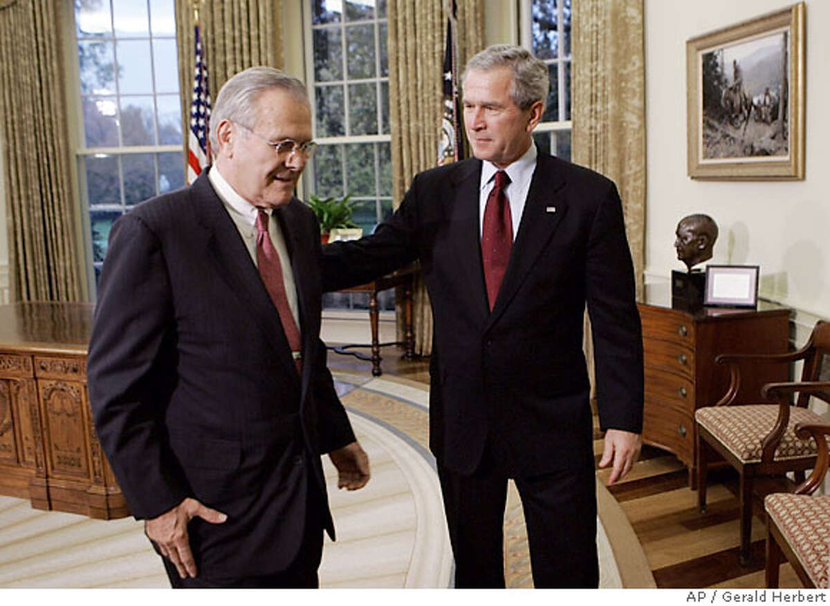 President Bush, right, walks out of the Oval Office of the White House in Washington, Wednesday, Nov. 8, 2006 with outgoing Defense Secretary Donald H. Rumsfeld after announcing that former CIA Director Robert Gates was nominated to replace Rumsfeld. (AP Photo/Gerald Herbert)