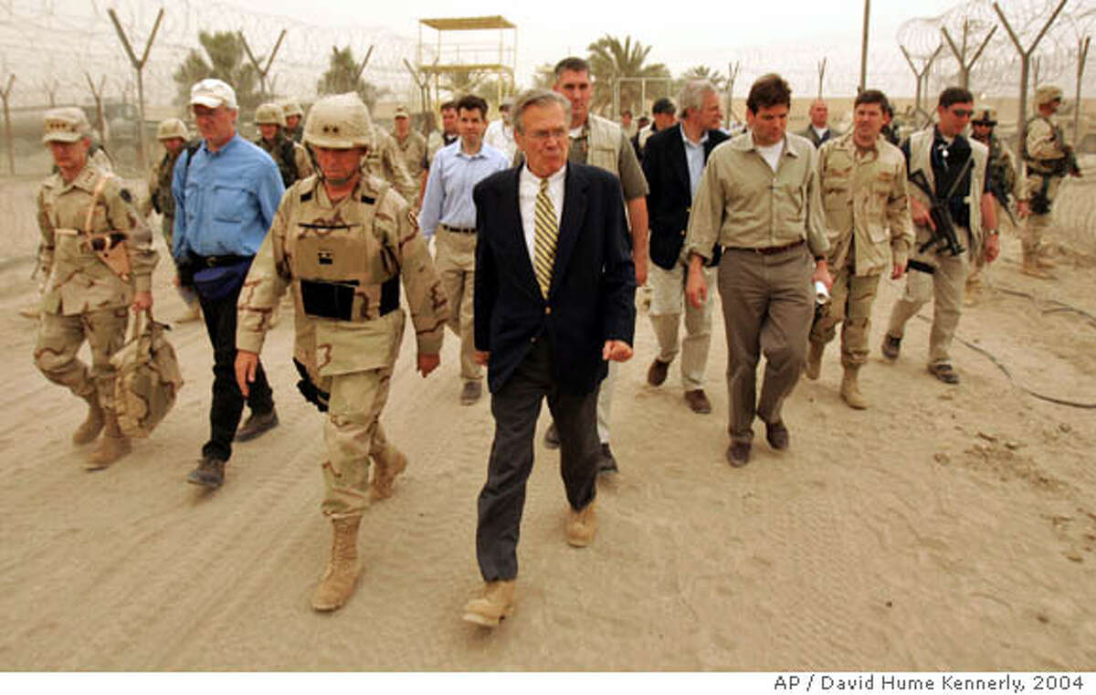 ** FIle ** U.S.Defense Secretary Donald H. Rumsfeld, right, tours with Maj. Gen. Geoffrey Miller, left, commander of the prison system in Iraq, the prison of Abu Ghraib, shortly after his arrival to Baghdad, Thursday, May 13, 2004. After years of defending his secretary of defense, President Bush on Wednesday Nov. 8, 2006 announced Rumsfeld's resignation within hours of the Democrats' triumph in congressional elections. Bush reached back to his father's administration to tap a former CIA director to run the Pentagon. (AP Photo/David Hume Kennerly, Pool)