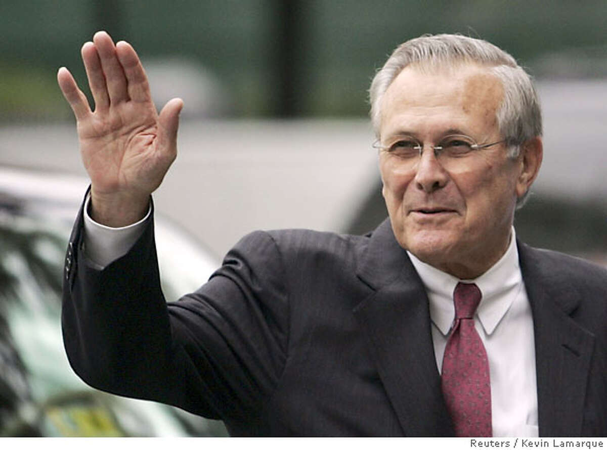 U.S. Secretary of Defense Donald Rumsfeld waves to well-wishers as he departs the White House after U.S. President George W. Bush announced Rumsfeld's replacement in Washington November 8, 2006. Rumsfeld, the controversial face of U.S. war policy, quit on Wednesday after Democrats rode Americans' anger and frustration over Iraq to victory in Tuesday's congressional elections. REUTERS/Kevin Lamarque (UNITED STATES)