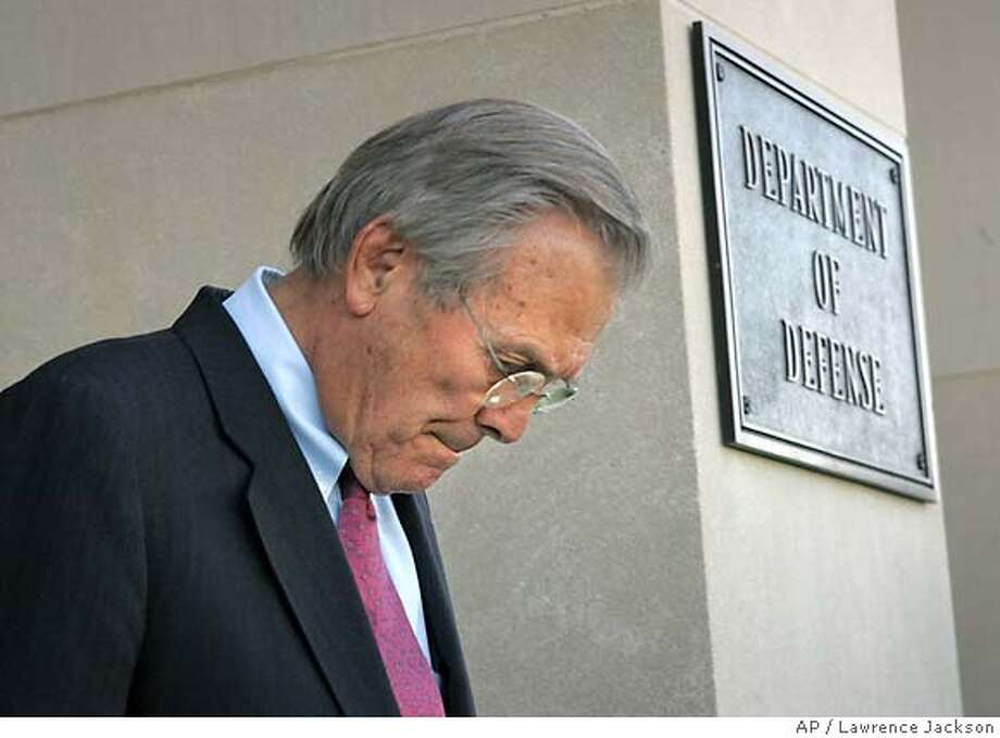 ** FILE ** Defense Secretary Donald H. Rumsfeld prepares to receive Mexican Navy Secretary Admiral Marco Antonio Peyrot, not shown, during an honor cordon at the Pentagon in this Oct. 30, 2006 file photo. Republican officials say Defense Secretary Donald Rumsfeld is stepping down. Word comes a day after the Democratic gains in the election, in which Rumsfeld was a focus of much of the criticism of the Iraq war. (AP Photo/Lawrence Jackson, File) Photo: LAWRENCE JACKSON