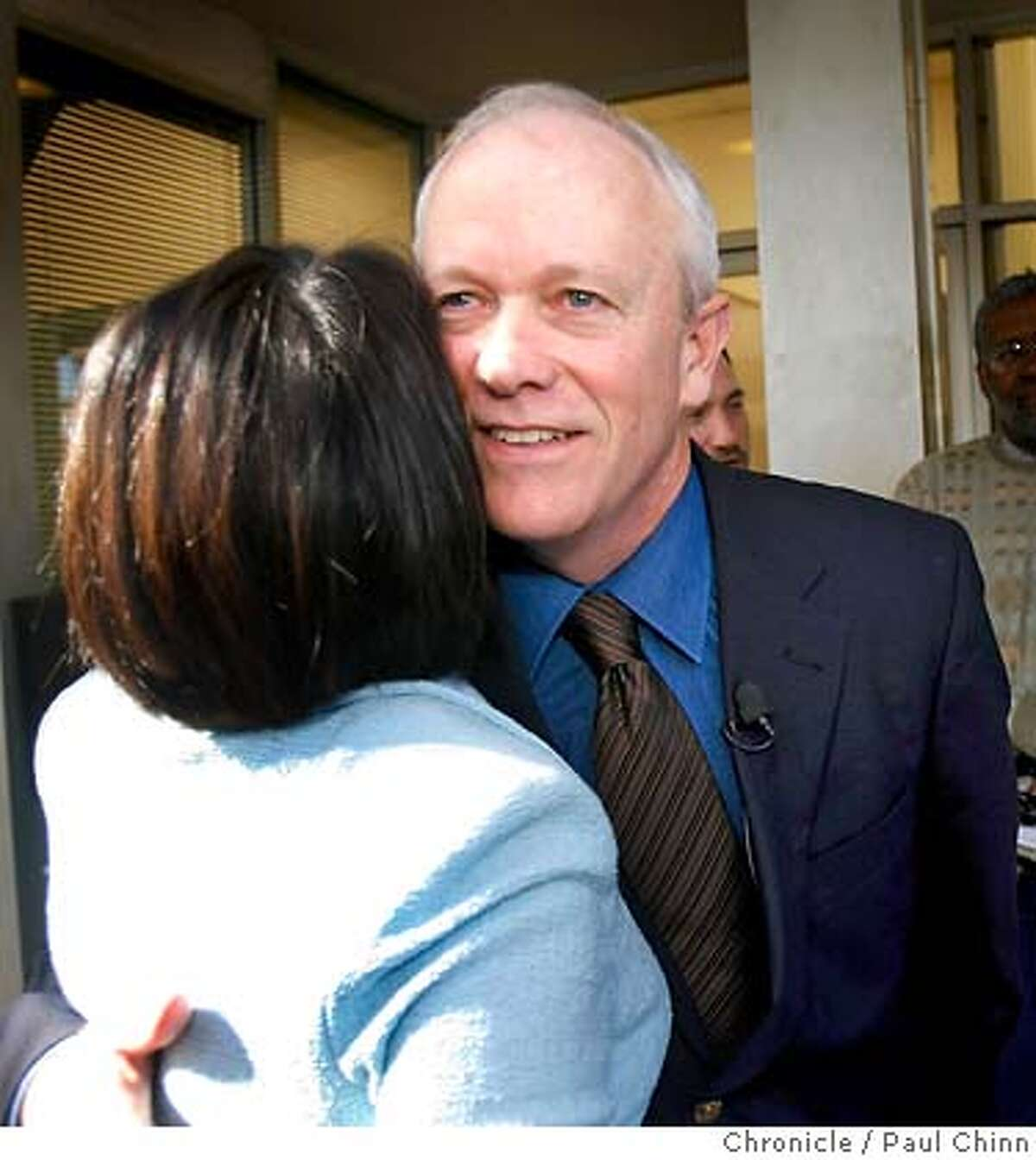 A supporter hugs Jerry McNerney at a Democratic Party victory rally in Oakland, Calif. on Wednesday, Nov. 8, 2006. McNerney defeated incumbent Rebublican Richard Pombo in the 11th district Congressional race. PAUL CHINN/The Chronicle **Jerry McNerney, Richard Pombo