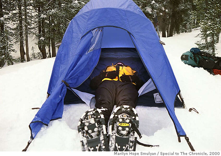 SNOWCAMP B/C/23JAN00/OT/HO Snow camping student Renee Montgomery test her tent for a tight fit during her outing with the Sierra Club. BY Marilyn Hope Smulyan/Special to the Chronicle Photo: Marilyn Hope Smulyan