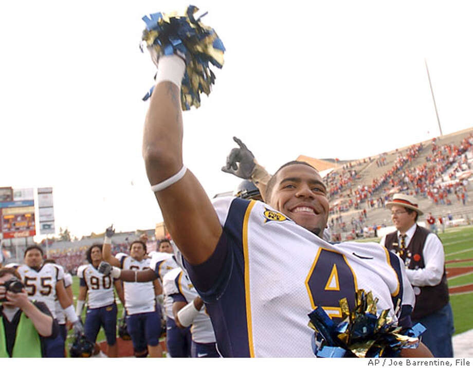 California's Thomas DeCoud celebrates with pom-poms after they beat Washington State, 21-3, in a college football action in Pullman, Wash., Saturday, Oct. 14, 2006. (AP Photo/Joe Barrentine) Photo: JOE BARRENTINE