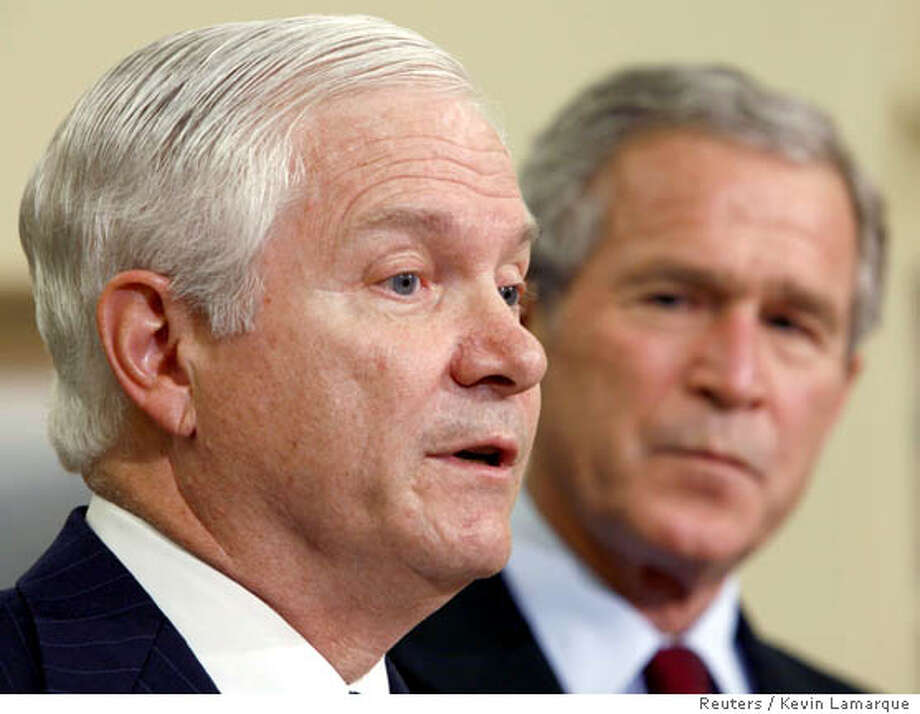 U.S. President George W. Bush (L) listens to Robert Gates speak after Bush announced that Gates will replace Donald Rumsfeld as Secretary of Defense at the White House in Washington November 8, 2006. Rumsfeld, the controversial face of U.S. war policy, quit on Wednesday after Democrats rode Americans' anger and frustration over Iraq to victory in Tuesday's congressional elections.  REUTERS/Kevin Lamarque (UNITED STATES)  Ran on: 11-09-2006  Robert Gates, with President Bush, is a member of George H.W. Bush's inner circle and is currently president at Texas A & M. Photo: KEVIN LAMARQUE