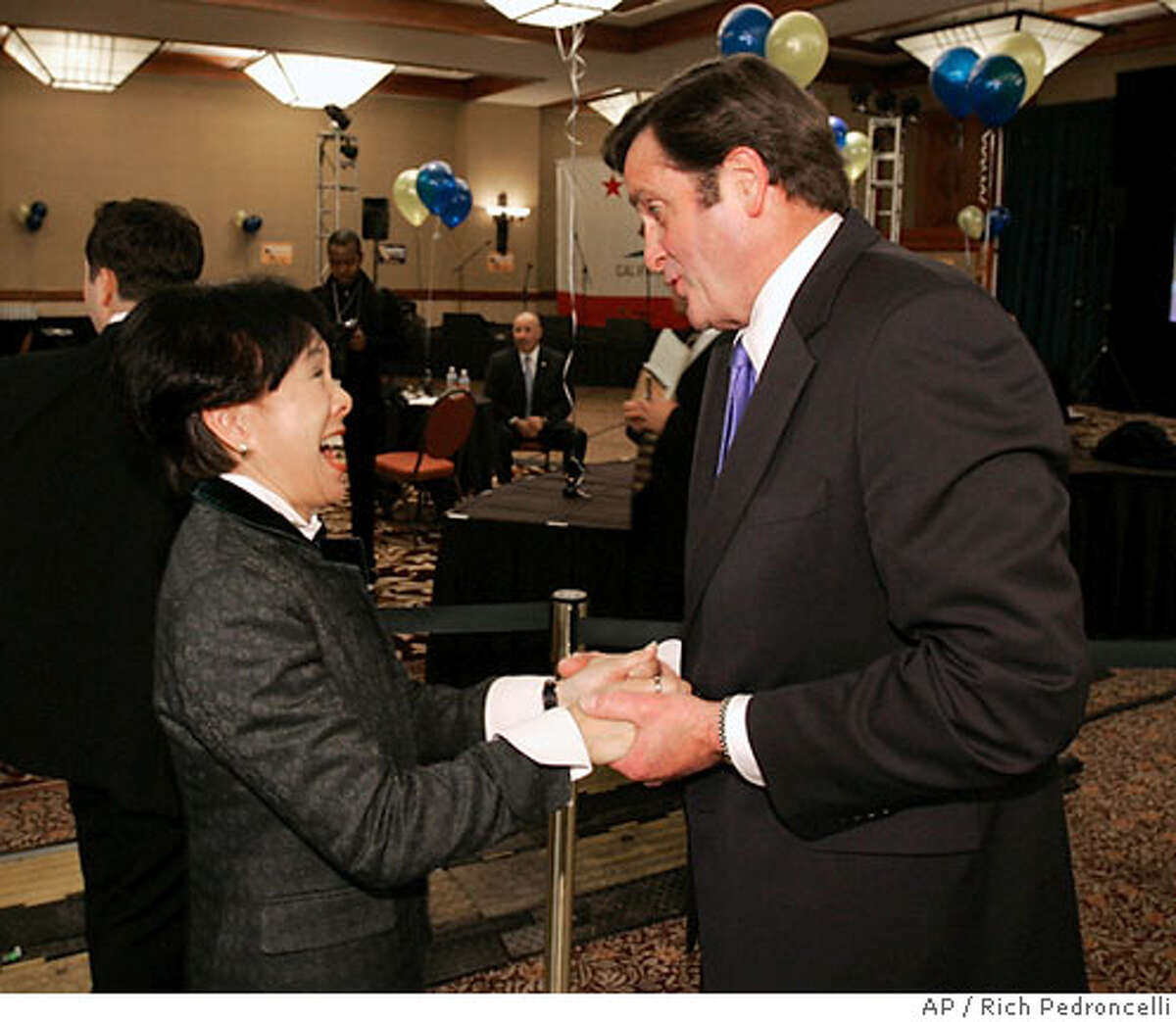 Rep. Doris Matsui, D-Sacramento, left, talks with Insurance Commissioner John Garamendi, the Democratic candidate for lieutenant governor, in the early evening hours of election night in Sacramento, Calif., Tuesday, Nov. 7, 2006. Garamendi is running against Republican state Sen. Tom McClintock. (AP Photo/Rich Pedroncelli)