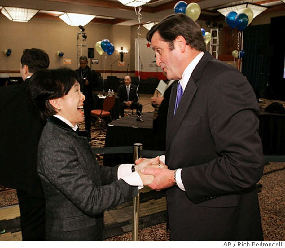Rep. Doris Matsui, D-Sacramento, left, talks with Insurance Commissioner John Garamendi, the Democratic candidate for lieutenant governor, in the early evening hours of election night in Sacramento, Calif., Tuesday, Nov. 7, 2006. Garamendi is running against Republican state Sen. Tom McClintock. (AP Photo/Rich Pedroncelli) Photo: RICH PEDRONCELLI