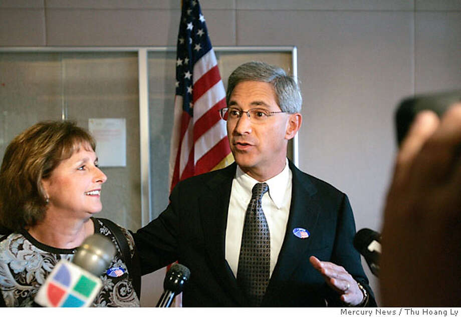 Steve Poizner, candidate for California State Insurance Commissioner, is flanked by his wife, Carol, as he talks to reporters after casting his absentee ballot at the Santa Clara County Registrar of Voters, in San Jose, Calif., Tuesday, Nov., 7, 2006. (AP Photo/Mercury News, Thu Hoang Ly) Photo: THU HOANG LY