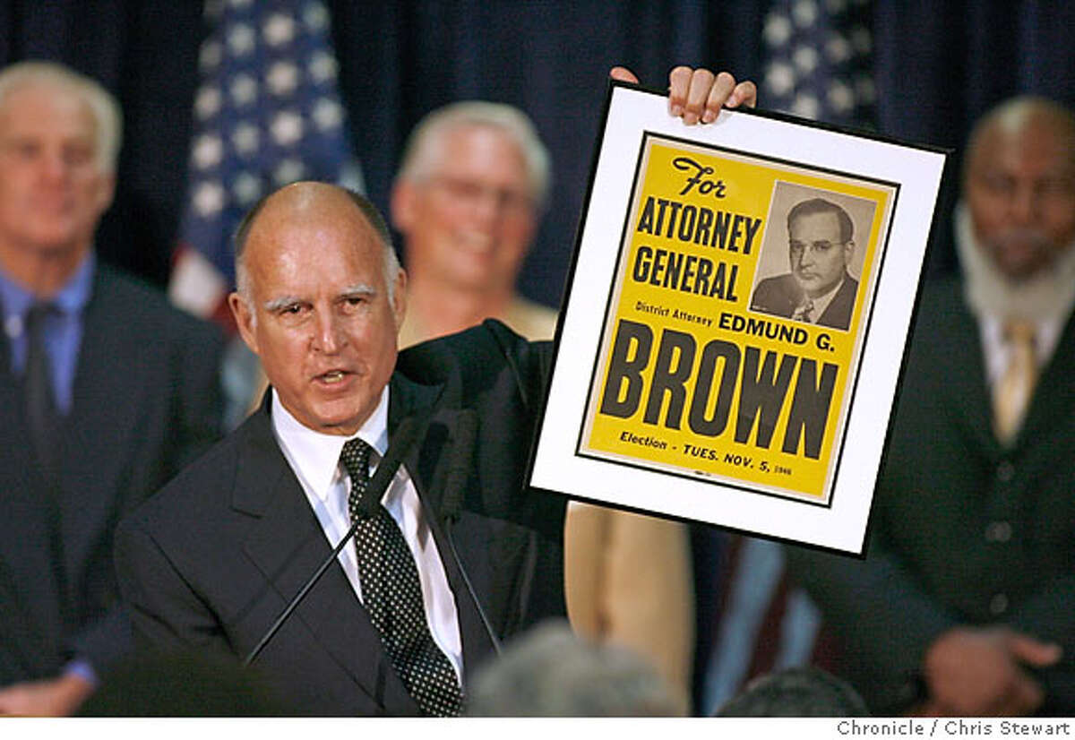 Newly-elected attorney general Jerry Brown holds up a 1946 campaign poster from when his father Pat Brown ran for the same office. Leading Democrats, including Dianne Feinstein, Jerry Brown, Barbara Boxer and Bill Lockyer attend a Democratic Party election night rally at Delancey St. Restaurant, Town Hall Rm., 600 Embarcadero, San Francisco. Chris Stewart / The Chronicle