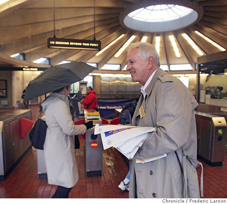 Berkeley Mayor Tom Bates greets commuters at the North Berkeley BART station to hope of being re-electioned. 11/2/06  {Photographed by Frederic Larson} Ran on: 11-08-2006  Mayor Tom Bates greets commuters at the BART's North Berkeley Station in some last-minute campaigning. Early returns show Bates defeating ex-Planning Commissioner Zelda Bronstein in the race.  Ran on: 11-08-2006 Photo: Frederic Larson