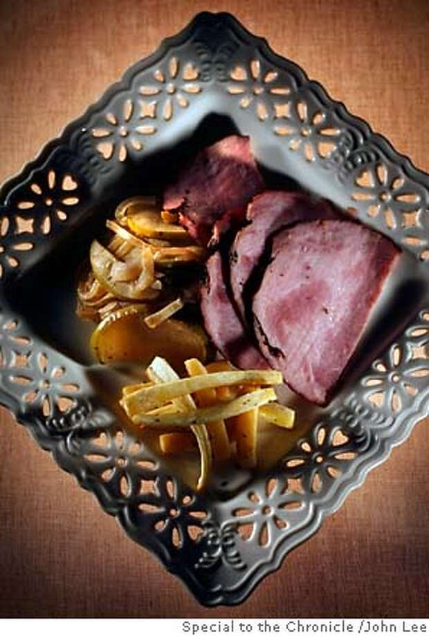 WORKING08_03JOHNLEE.JPG  Ham with apples and root vegetables.  By JOHN LEE/SPECIAL TO THE CHRONICLE Photo: JOHN LEE