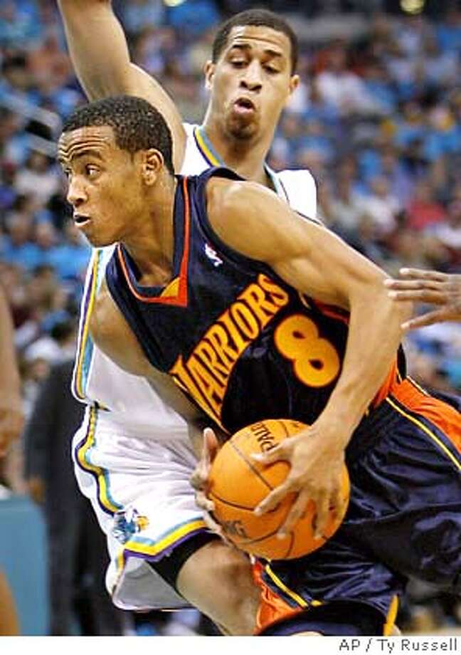 Golden State Warriors guard Monta Ellis (8) drives the ball past New Orleans Hornets guard Jannero Pargo in the first half of an NBA basketball game Tuesday, Nov. 7, 2006, in Oklahoma City. (AP Photo/Ty Russell) Photo: TY RUSSELL