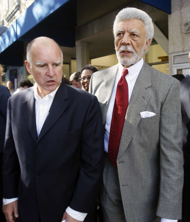 Outgoing Oakland Mayor, and state Attorney General-elect, Jerry Brown (left), walks with Oakland Mayor-elect Ron Dellums after a Democratic Party victory rally in Oakland, Calif. on Wednesday, Nov. 8, 2006. PAUL CHINN/The Chronicle  **Jerry Brown, Ron Dellums Photo: PAUL CHINN