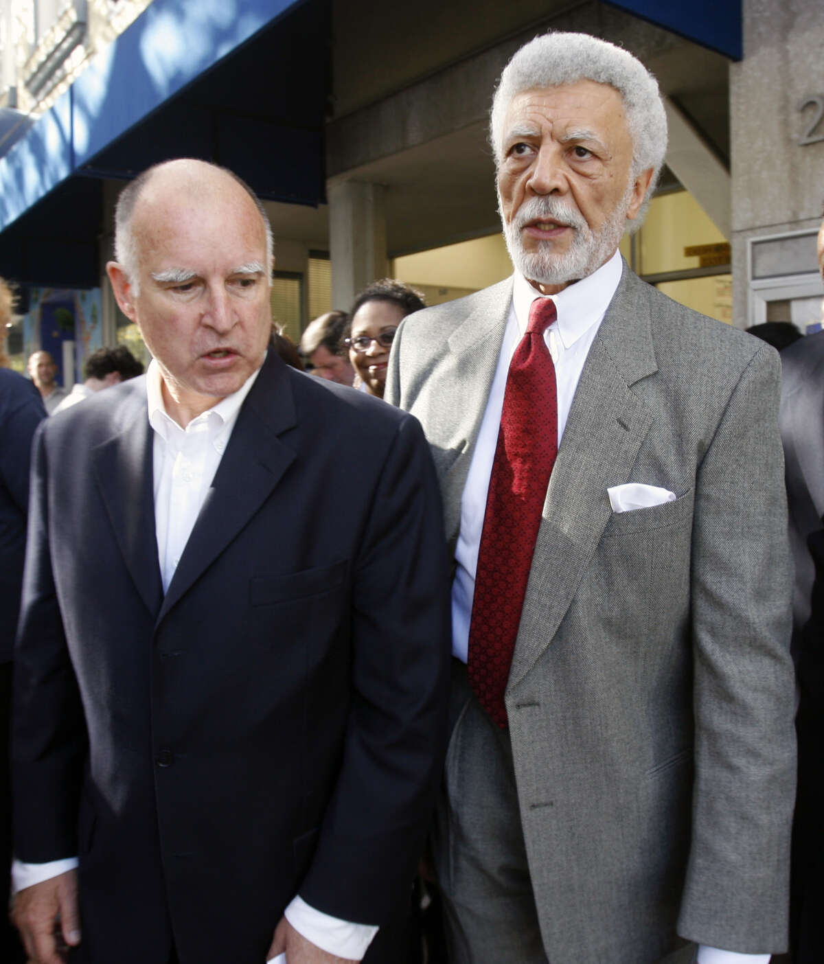 Outgoing Oakland Mayor, and state Attorney General-elect, Jerry Brown (left), walks with Oakland Mayor-elect Ron Dellums after a Democratic Party victory rally in Oakland, Calif. on Wednesday, Nov. 8, 2006.