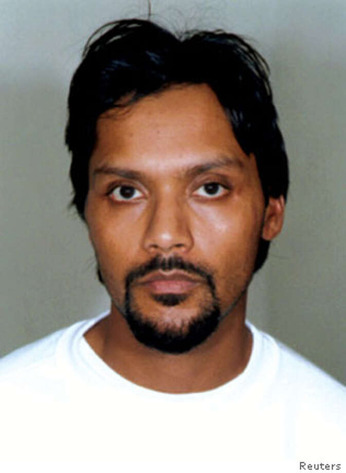 "A police handout photograph released on November 6, 2006 shows Britain's Dhiren Barot, 34, who appeared for sentencing before Woolwich Crown Court, east London on Monday. Barot pleaded guilty to plotting to blow up financial targets in the United States and carry out ""dirty bomb"" attacks in Britain. ONE USE ONLY NO ARCHIVE IMAGE CAN ONLY BE USED TO REPORT THIS CASE OR INCIDENT REUTERS/Handout (BRITAIN)  Ran on: 11-08-2006  Dhiren Barot is accused in the United States of plotting to blow up financial targets. Photo: HO"