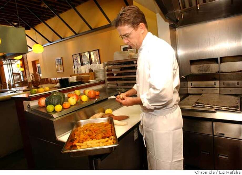 Grasshopper's Donald Dellis closes his College Avenue restaurant this weekend. Chronicle file photo, 2003, by Liz Hafalia