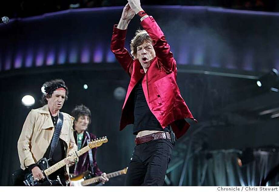 "The Rolling Stones Mick Jagger (center) joined mates Keith Richards (left), Ron Wood and Charlie Watts (not pictured), as they play ""Jumping Jack Flash"" at McAfee Coliseum in Oakland on their ""A Bigger Bang"" tour tonight, November 6, 2006.  Chris Stewart / The Chronicle Photo: Chris Stewart"