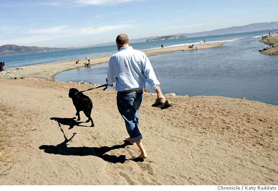 "SHOWN: Eric Haesloop walks his dog, Kona, along the estuary at Crissy Field. He loves the estuary lagoon and wetlands for their small scale effect and restraint. Eric Haesloop, of the architectural firm Turnbull, Griffin, & Haesloop, takes us on an ""Architect Walk"" along Crissy Field. He loves looking at the architecture in the larger landscape, from the grand scale like the Golden Gate Bridge to the smaller scale of the fishing pier and smaller buildings. He loves the sculpted land forms, such as the berms, that were added when the area was developed. He loves the estuary, and the restraint of the whole project. Dog's name is ""Kona."" These pictures made on WEDNESDAY, SEPT. 20, 2006, in San Francisco, CA. (Katy Raddatz/The S.F.Chronicle)  **Eric Haesloop Photo: Katy Raddatz"