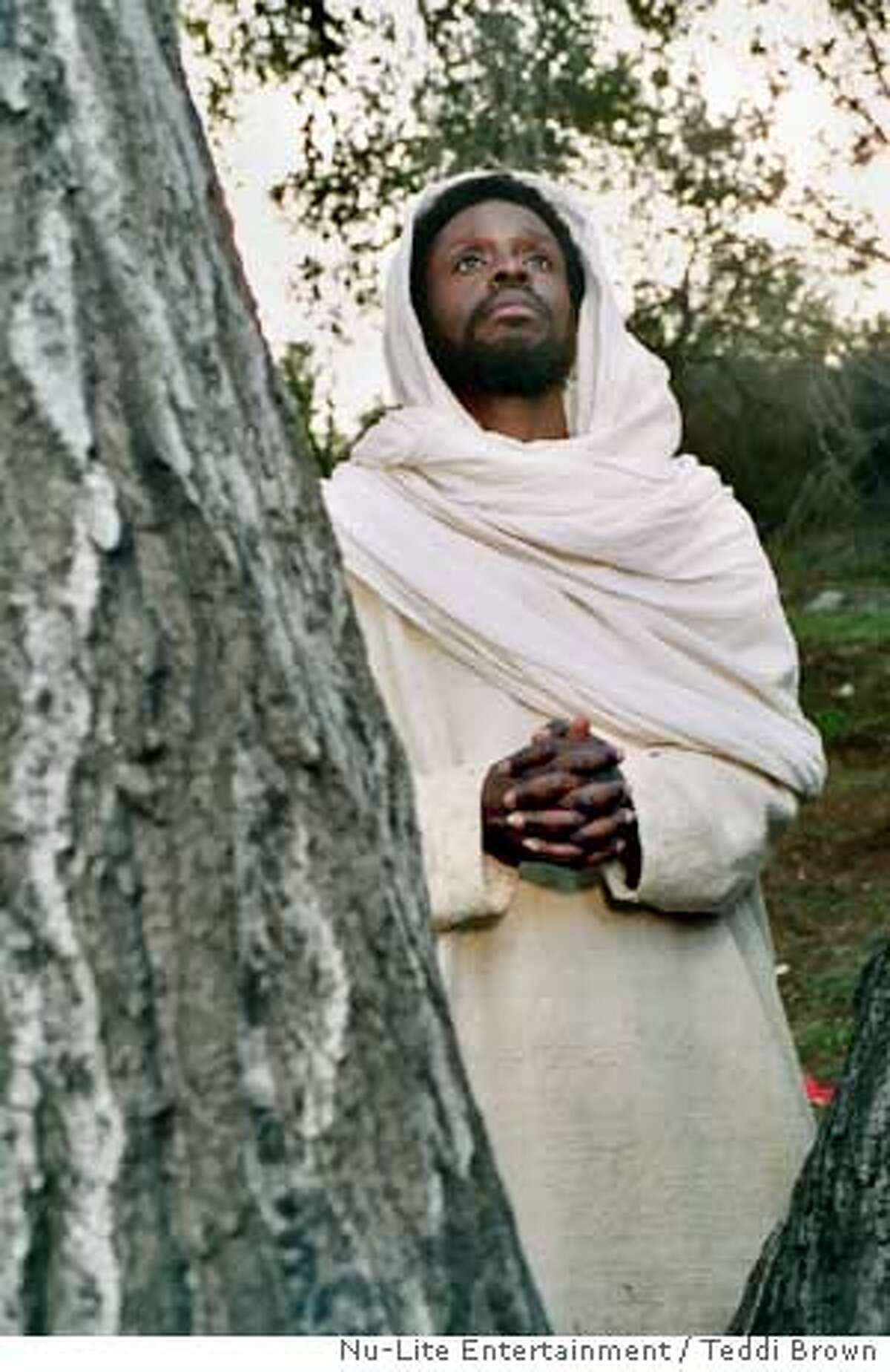 """This undated photo released by Nu-Lite Entertainment shows Jean Claude LaMarre, who wrote, directed and stars as Jesus in a scene from """"Color of the Cross."""" The film is the first representation in the history of American cinema of Jesus as a black man, and that could have a lasting impact on contemporary religious iconography. (AP Photo/ Nu-Lite Entertainment, Teddi Brown)"""