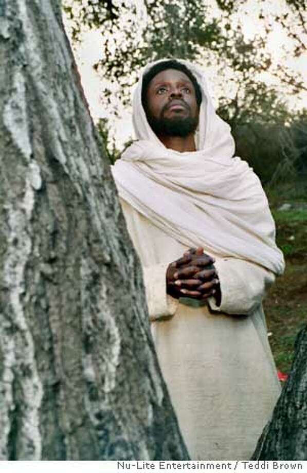 "This undated photo released by Nu-Lite Entertainment shows Jean Claude LaMarre, who wrote, directed and stars as Jesus in a scene from ""Color of the Cross."" The film is the first representation in the history of American cinema of Jesus as a black man, and that could have a lasting impact on contemporary religious iconography. (AP Photo/ Nu-Lite Entertainment, Teddi Brown) Photo: TEDDI BROWN"