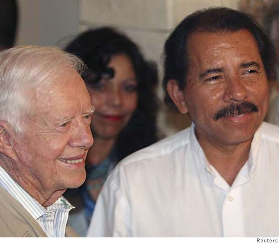 Sandinista leader and presidential candidate Daniel Ortega and former U.S. President Jimmy Carter (L) smile before their meeting at a hotel in Managua November 6, 2006. REUTERS/Str (NICARAGUA)  Ran on: 11-07-2006  Daniel Ortega appears in Managua with former U.S. President Jimmy Carter (left), an election observer.  Ran on: 11-07-2006  Daniel Ortega appears in Managua with former U.S. President Jimmy Carter (left), an election observer. Photo: STR