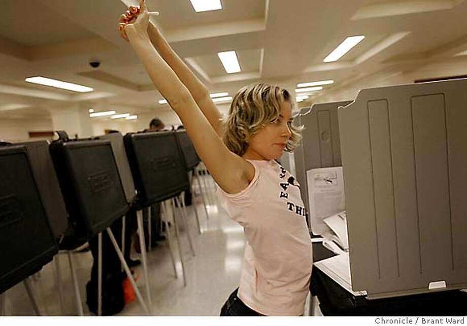 vote095.JPG  Amelia Radtke stretched after carefully making her choices.  Scenes of absentee voters making their choices in the basement of City Hall Monday.  {Brant Ward/San Francisco Chronicle}11/6/06 Photo: Brant Ward